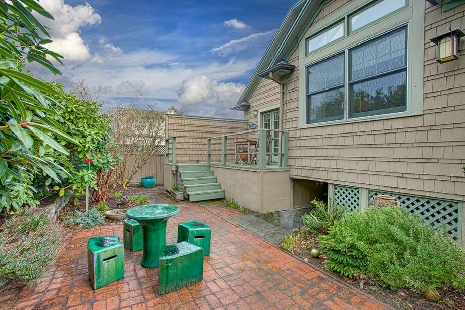 Deck and patio of 207 25th Ave. The 2,210-square-foot house, built in 1926, has three bedrooms, two bathrooms, a family room, French doors, vaulted ceilings and skylights on a 3,040-square-foot lot. It's listed for $489,000, although a sale is pending. Photo: Courtesy Deirdre Doyle And Brad Hinckley/Windermere Real Estate