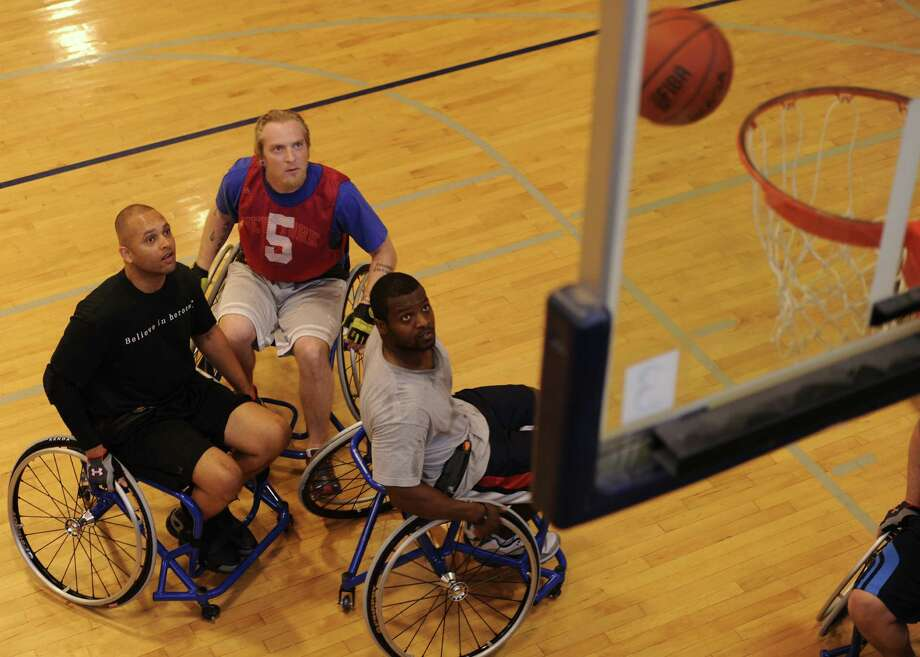 U.S. Air Force members play wheelchair basketball March 22 during an Air Force Adaptive Sports Program camp at the Rambler Fitness Center at Randolph AFB. Photo: U.S. Air Force Photo