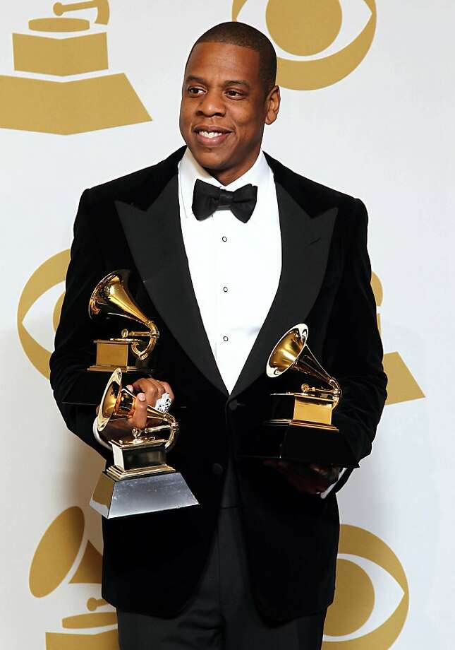 "FILE - In this Feb. 10, 2013 file photo, Jay-Z poses backstage with the awards for best rap/sung collaboration for ""No Church in the Wild"" and best rap performance for ""N****s in Paris"" at the 55th annual Grammy Awards, in Los Angeles.  Jay-Z is among 11 celebrities and government officials whose private financial information appears to have been posted online by a site that began garnering attention on Monday, March 11, 2013. (Photo by Matt Sayles/Invision/AP, File) Photo: Matt Sayles, Associated Press"