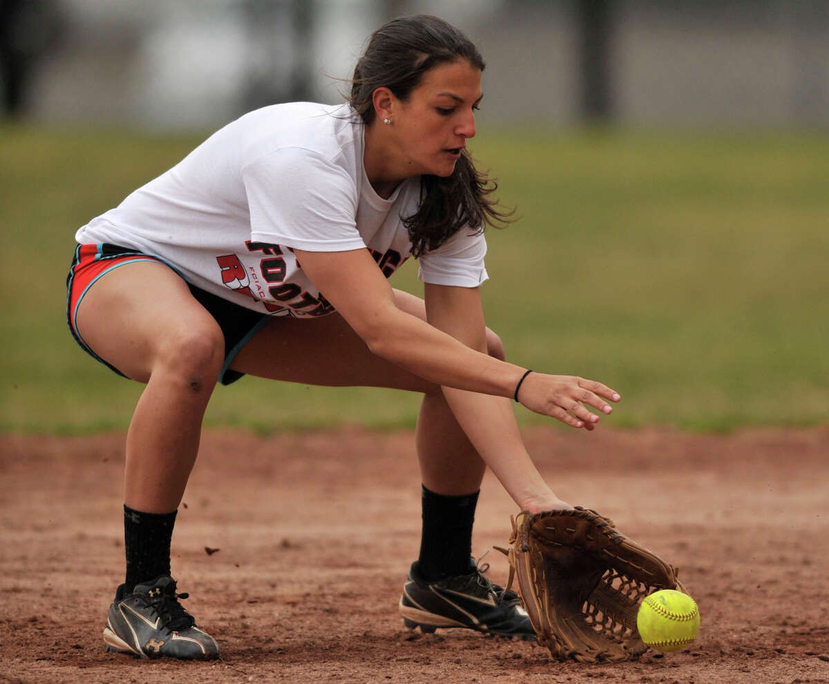Senior co-captain Krista Robustelli fields a ball at shortstop during softball practice at Stamford High School on Monday, April 1, 2013.