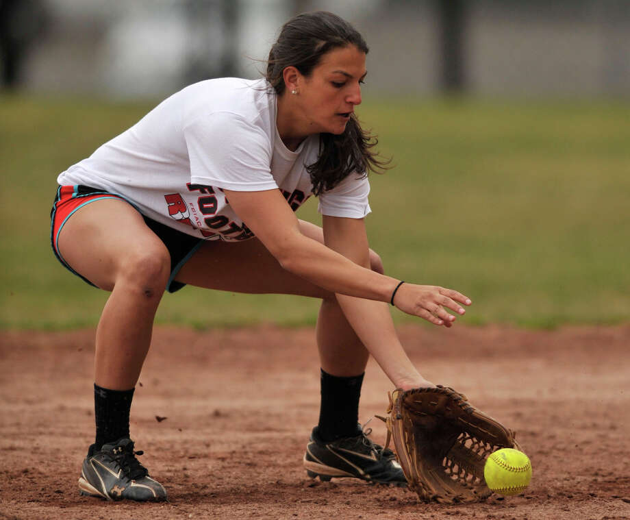 Senior co-captain Krista Robustelli fields a ball at shortstop during softball practice at Stamford High School on Monday, April 1, 2013. Photo: Jason Rearick / The (Stamford) Advocate