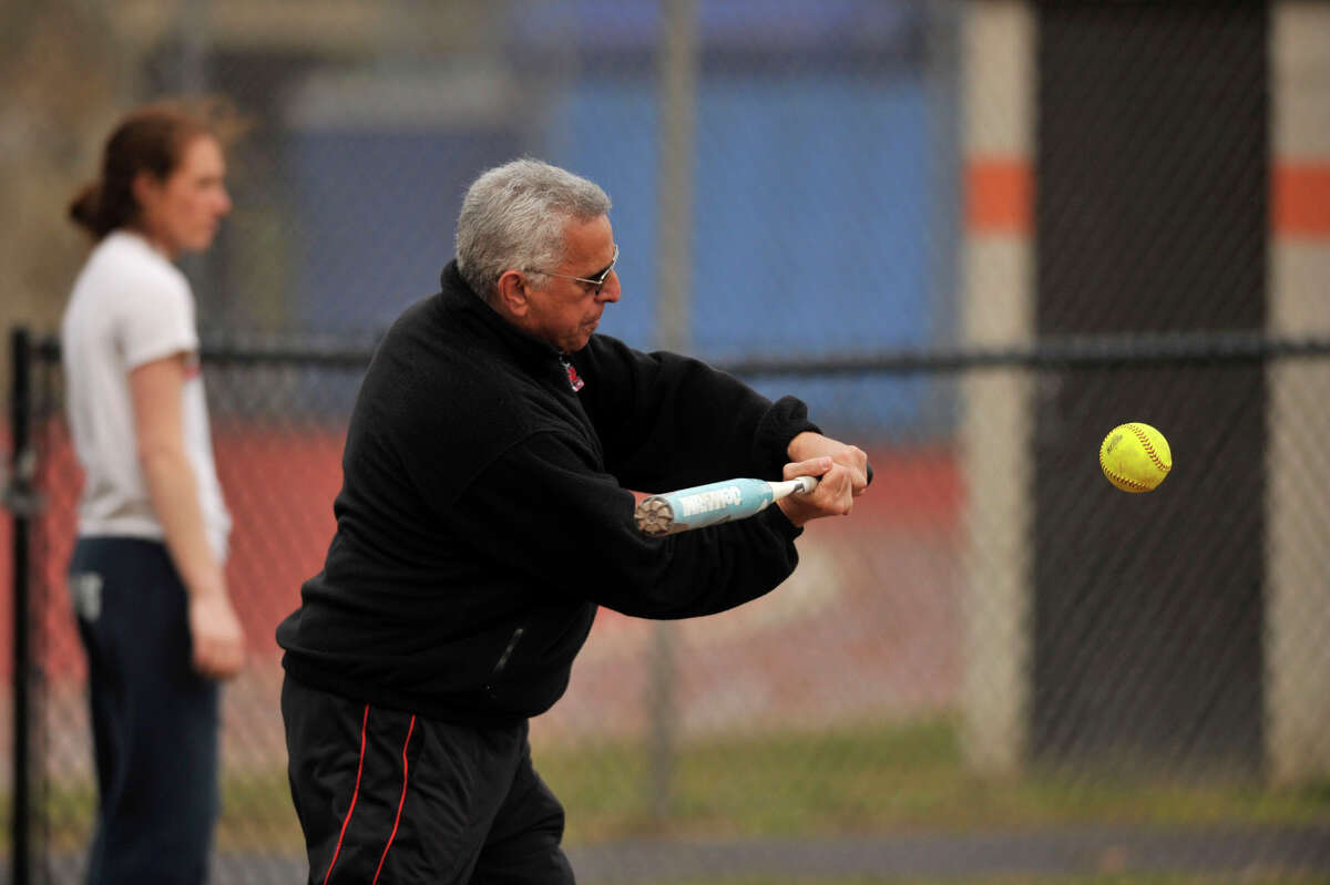 Stamford girls softball head coach Tony Esposito hits a ball for fielding practice at Stamford High School on Monday, April 1, 2013.