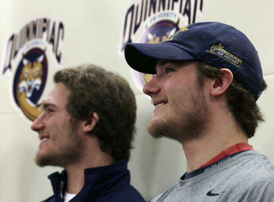Quinnipiac forward Connor Jones, right, smiles with his twin brother Kellen, who is also a Quinnipiac forward, during a news conference at the university in Hamden, Conn., Tuesday, April 2, 2013. Quinnipiac will face St. Cloud State in a national semifinal at the NCAA hockey Frozen Four. (AP Photo/Charles Krupa)