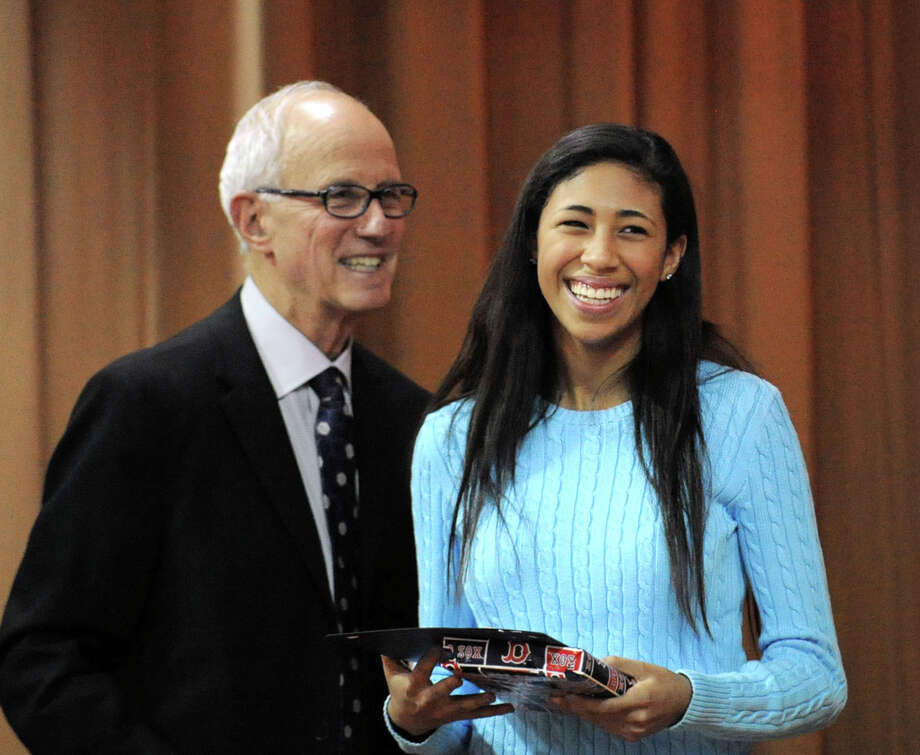 Greenwich High School senior Jenny Cespedes, right, smiles after receiving the Fleishman Service Award from the award's namesake, former Superintendent of Schools Ernest Fleishman, left, during the Greenwich Public Schools Community Service Awards ceremony at Parkway School in Greenwich, Tuesday, April 2, 2013. The awards are given to students based on participation in service activities that help to improve both their school and community. Photo: Bob Luckey / Greenwich Time