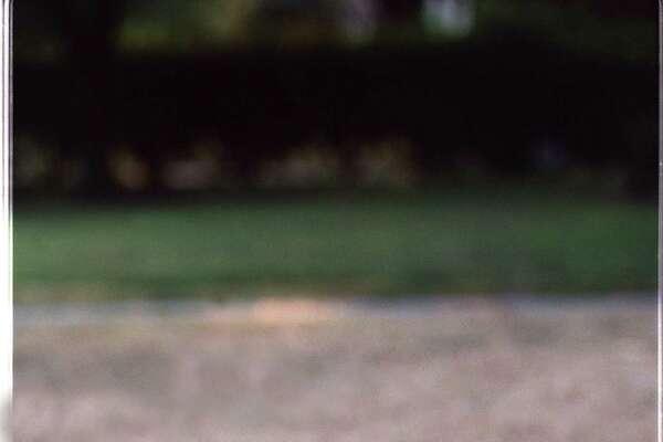 Photo illustration on brown lawns, hot weather , dead grass, etc.. Rick Hunter/Staff