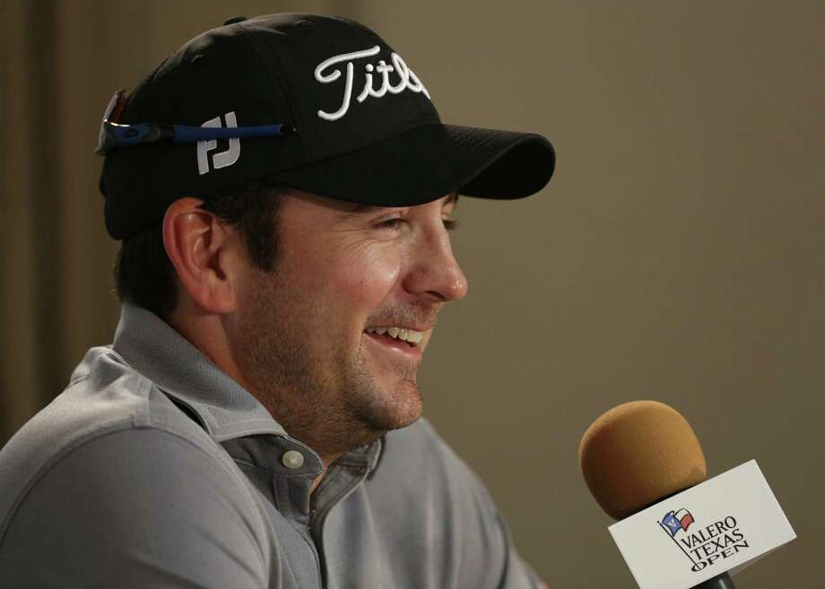 Last years Texas Open winner, Ben Curtis, shares a smile as he is interviewed by the media at the 2013 Valero Texas Open at the AT&T Oaks Course on Tuesday, April 2, 2013. Photo: Bob Owen, San Antonio Express-News / ©2013 San Antonio Express-News