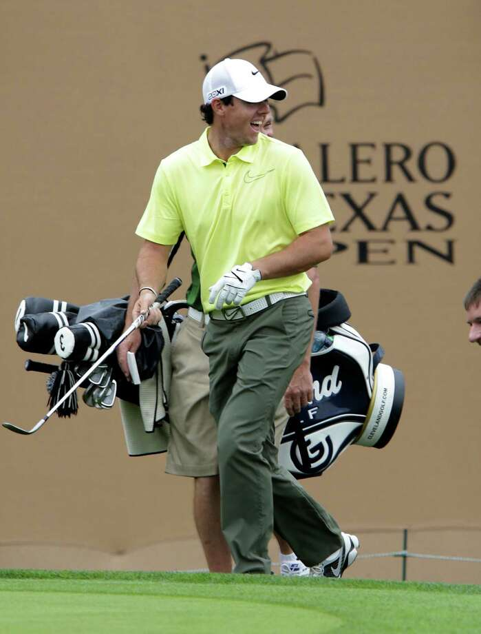 Rory McIlroy enjoys a laugh as he walks up to the 18th green during a warm up round at the 2013 Valero Texas Open at the AT&T Oaks Course on Tuesday, April 2, 2013. Photo: Bob Owen, San Antonio Express-News / ©2013 San Antonio Express-News