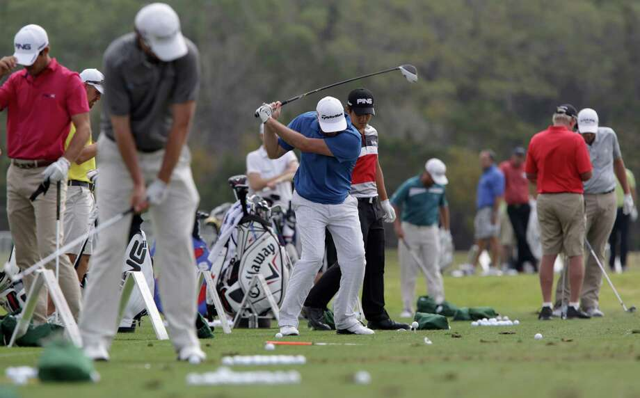 Professional golfers line up on the practice driving range at the 2013 Valero Texas Open at the AT&T Oaks Course on Tuesday, April 2, 2013. Photo: Bob Owen, San Antonio Express-News / ©2013 San Antonio Express-News