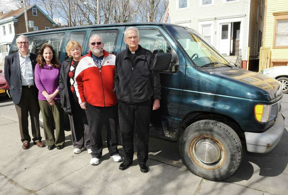 From left, community activists Gary McCann, Mary Biordano, Judy Houck, Dr. Bob Paeglow and Fr. Frank O'Conner at Koinonia Primary Care with a van they use to transport homeless people on Friday, March 29, 2013 in Albany, N.Y. They are forming a new chapter of Family Promise of Albany County, a faith-based homeless assistance program that is part of a national movement. (Lori Van Buren / Times Union) Photo: Lori Van Buren