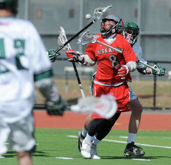 Niskayuna's Aidan O'Brien takes gets the ball knocked out of his stick during a lacrosse game agains