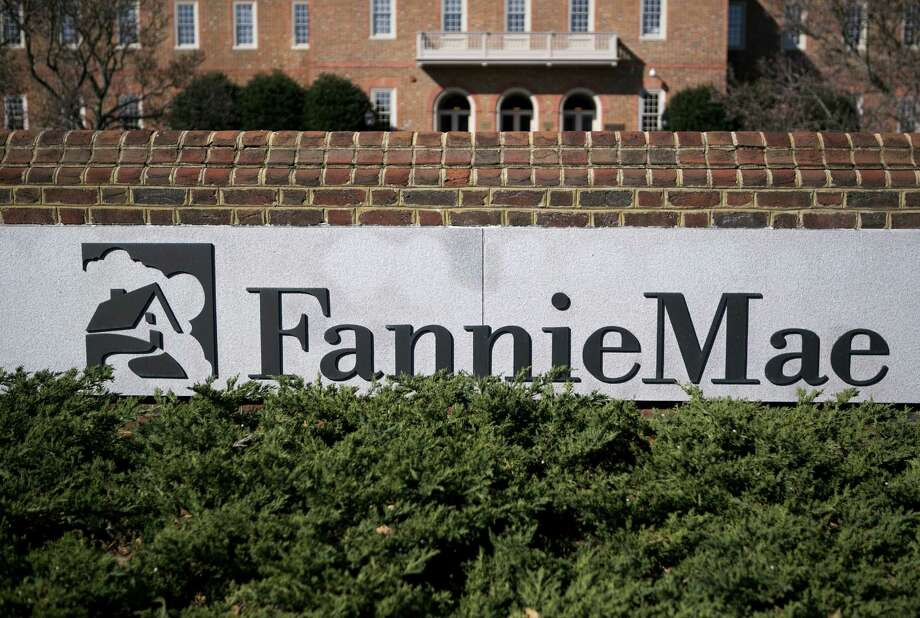 Fannie Mae, seized by U.S. regulators during the credit crisis, reported the largest annual profit in company history as a housing rebound helped the firm stop drawing federal aid. Photo: Andrew Harrer / Bloomberg News