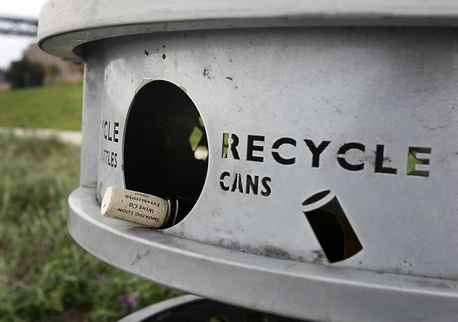 S.F. doesn't have dedicated public bins for recyclables, but many street cans have baskets attached for those items. Photo: Paul Chinn, The Chronicle