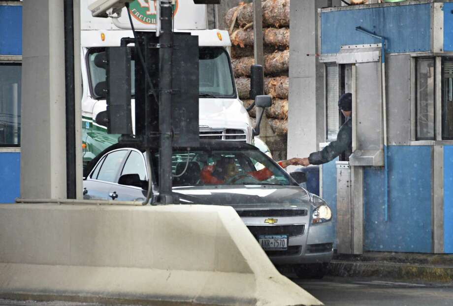 Thruway toll taker at exit 24 in Albany Tuesday April 2, 2013.  (John Carl D'Annibale / Times Union) Photo: John Carl D'Annibale