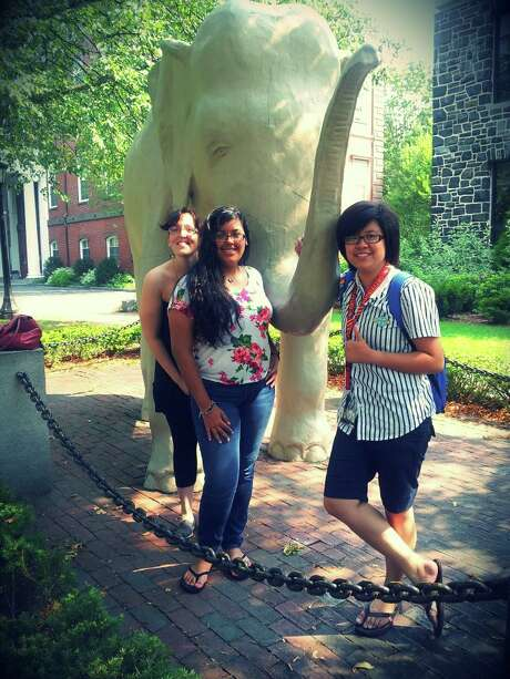 "EMERGE co-founder Anna Lugo, left, visited students Daniela Salazar and Phuong Ta last summer at Tufts University, where both are now enrolled as freshmen. ""If it had not been for EMERGE, I wouldn't be here right now,"" Ta said. ""It's really hard to imagine how my life would go without EMERGE intervening in it."""