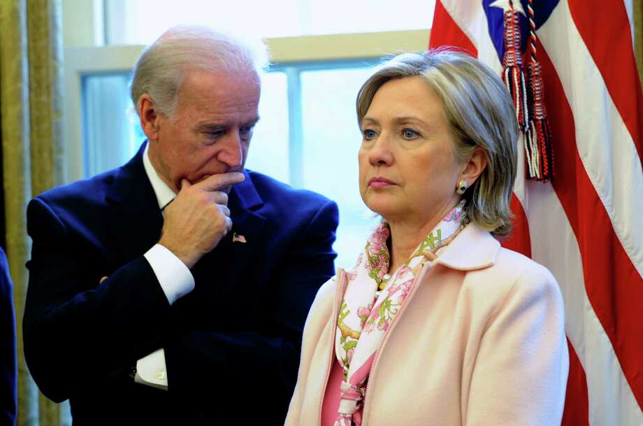 FILE - In this Dec. 7, 2009 file photo, then-Secretary of State Hillary Rodham Clinton stands with Vice President Joe Biden in the Oval Office of the White House in Washington. As Hillary Rodham Clinton's supporters urge her to run for president in 2016, the former first lady/senator/secretary of state makes her first public appearance since leaving government. Many Democrats see Clinton as the party's early front-runner, and some want her to signal her interest soon to lock down donors and supporters. Fueling the 2016 chatter: Vice President Joe Biden, another possible candidate, will speak at the same awards ceremony.  (AP Photo/Susan Walsh, File) Photo: Susan Walsh