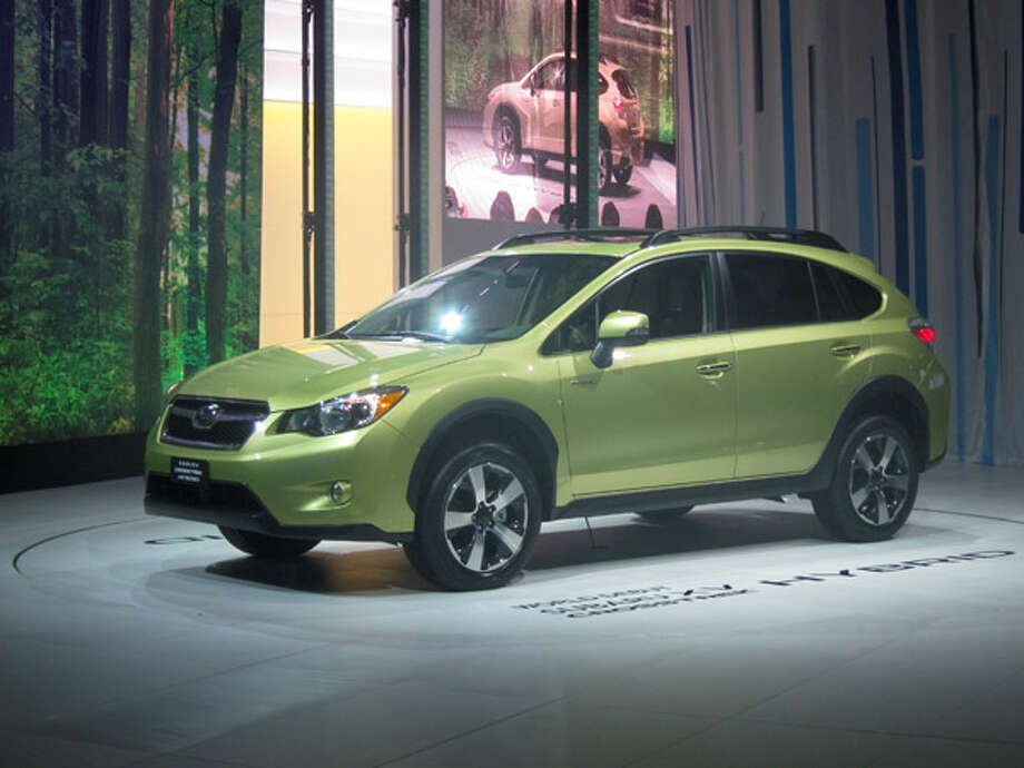 Subaru XV HybridIt's green, both figuratively and literally. Subaru's first hybrid promises to be the most fuel-efficient crossover on the market. The 13-hp electric motor is mounted on the opposite end of the continuously variable transmission from the 2.0-liter boxer-4 engine, allowing for limited electric-only propulsion and start-stop. Because the hybrid system adds about 300 lbs. (including a 13.5 kW battery pack), the suspension has been retuned and, Subaru claims, handling should improve. Photo: Popular Mechanics