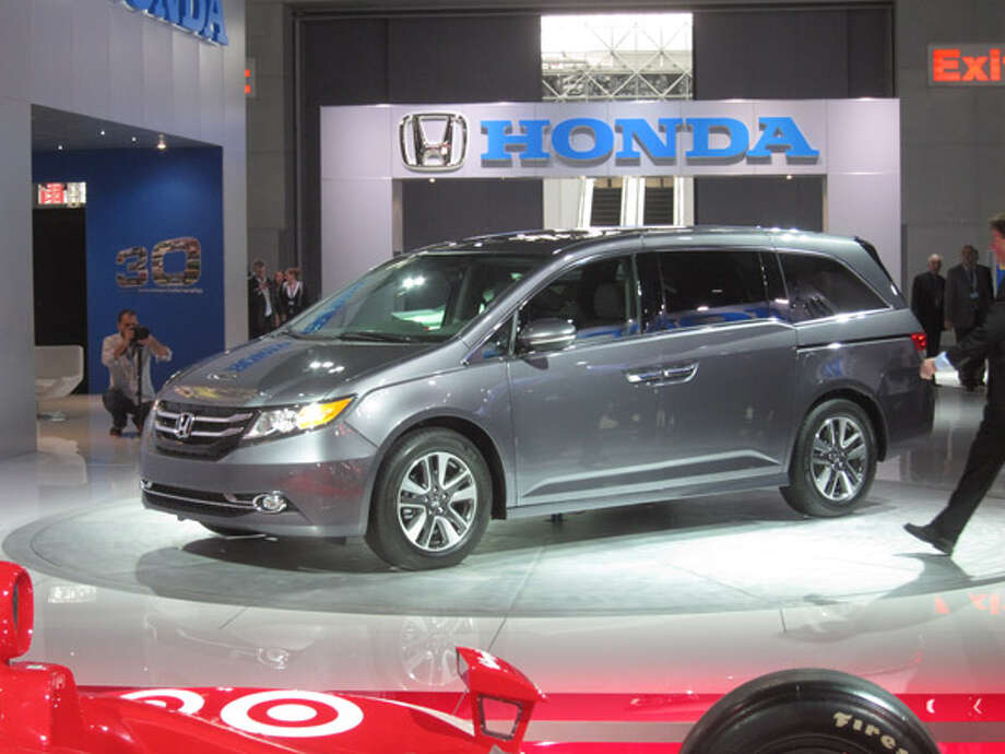 Honda OdysseyThe big news about the updated Honda Odyssey is not the new front styling, nor the revised interior with dual-screen infotainment system (also found in the Accord and Acura RLX and MDX). It's the built-in vacuum cleaner on the top-of-the-line Touring Elite Model. The Honda Vac, co-developed with Shop Vac, tucks into the side of the rear cargo area and has a hose that reaches to every corner of the cabin. A removable dust bin makes for easy disposal of all those dried-up french fries. Photo: Popular Mechanics