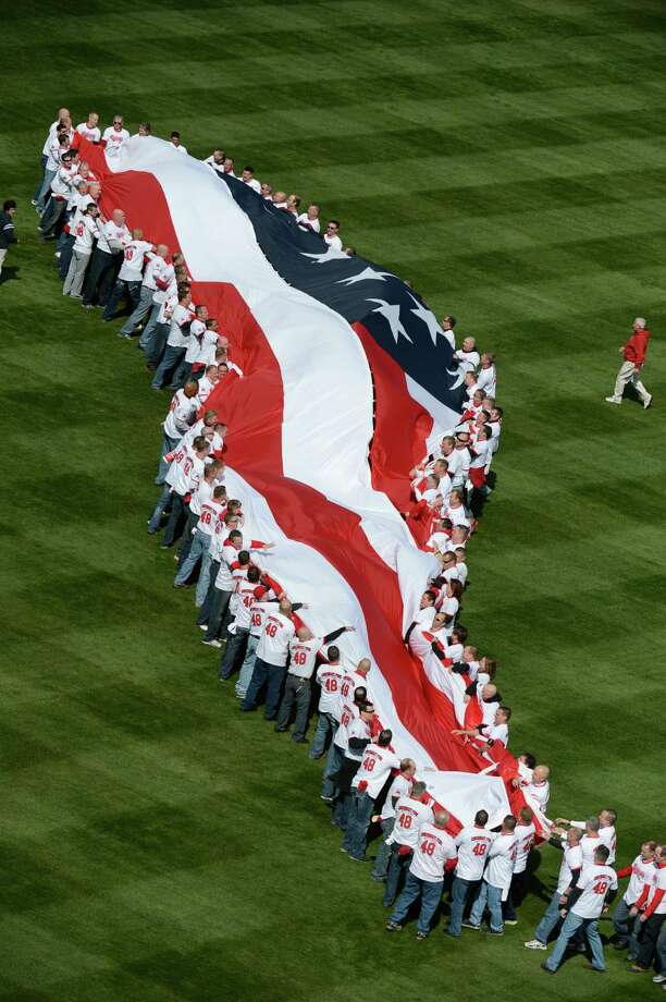 "The first of many poems/songs written about the flag -- before numerous country songs -- was Francis Scott Key's ""The Star-Spangled Banner."" It was made into a musical composition after it was a Key poem. Photo: Michael Keating, Associated Press"