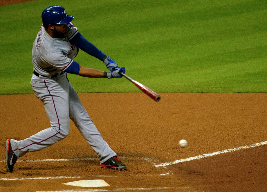 Rangers shortstop Elvis Andrus grounds to short during the first inning. Photo: Cody Duty / © 2013 Houston Chronicle