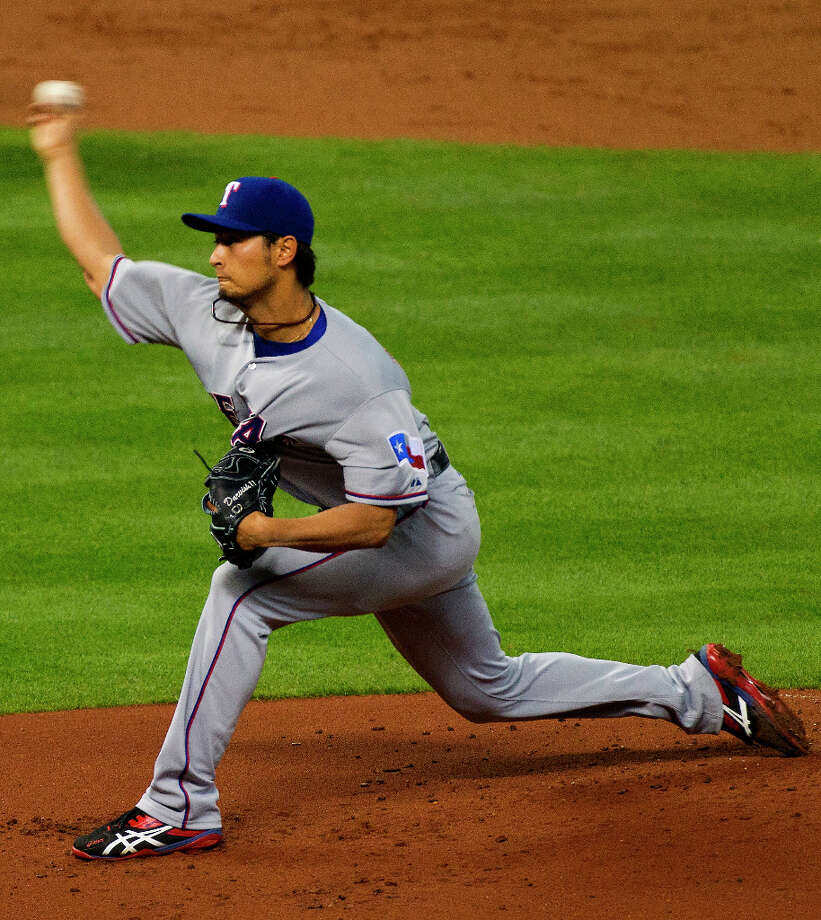 Rangers pitcher Yu Darvish delivers a pitch to the Astros during the first inning. Photo: Cody Duty / © 2013 Houston Chronicle