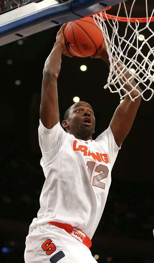 NEW YORK, NY - MARCH 13: Baye Keita #12 of the Syracuse Orange goes up for a dunk against the Seton Hall Pirates during the second round of the Big East Tournament at Madison Square Garden on March 13, 2013 in New York City.  (Photo by Elsa/Getty Images) Photo: Elsa / 2013 Getty Images