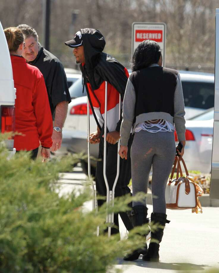 Louisville basketball player Kevin Ware, center, walks to the back doors of the Yum! Center to be reunited with his teammates, Tuesday, April 2, 2013, in Louisville, Ky. Ware was back on campus Tuesday afternoon after he had been released from an Indianapolis hospital, two days after breaking his right leg during the Cardinals' Final Four-clinching victory. (AP Photo/The Courier-Journal, John Sommers II) NO SALES; MAGS OUT; NO ARCHIVE; MANDATORY CREDIT Photo: John Sommers II