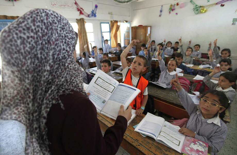 Palestinian kids attend a class at the UNRWA elementary school in Shati refugee camp in Gaza City. The Hamas-controlled parliament has passed a law requiring separate classes for boys and girls from fourth grade on. Photo: Hatem Moussa / Associated Press
