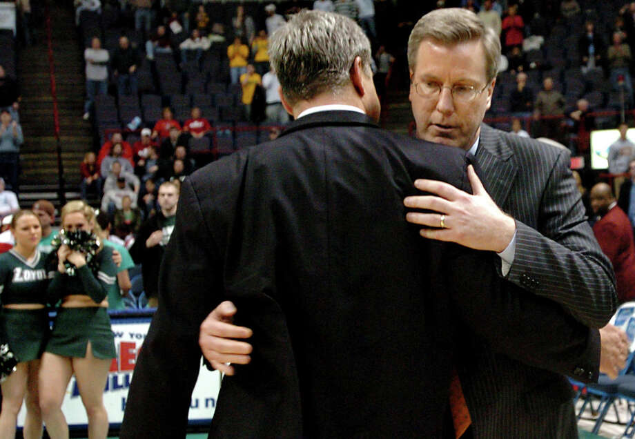 Times Union staff photo by Cindy Schultz -- Siena coach Fran McCaffery embraces Loyola coach Jimmy Patsos after Siena's 65-63 win over Loyola during their basketball game during the MAAC Tournament on Sunday, March 9, 2008, at the Times Union Center in Albany, N.Y. (WITH STORY) Photo: CINDY SCHULTZ / ALBANY TIMES UNION