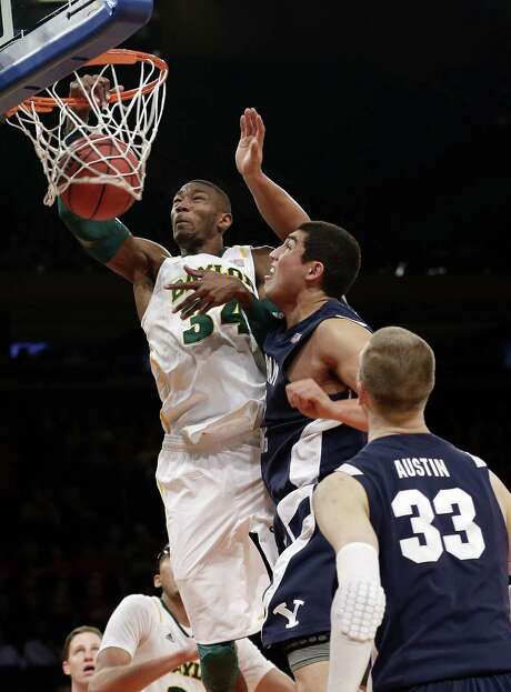 Baylor's Cory Jefferson dunks as Brigham Young's Bronson Kaufusi defends during the first half in New York. Photo: Frank Franklin / Associated Press