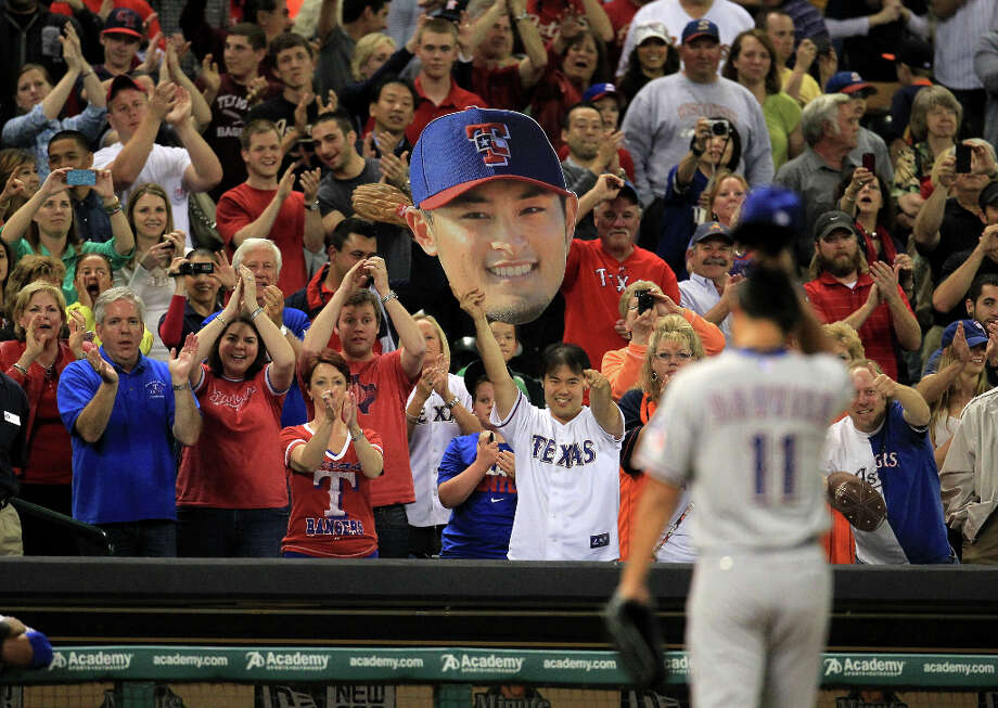 Fans react as Rangers pitcher Yu Darvish leaves the field after giving up a hit to Marwin Gonzalez of the Astros. Photo: Karen Warren / © 2013 Houston Chronicle