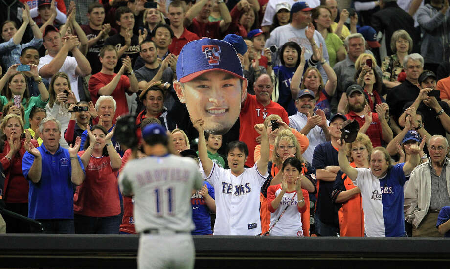 Fans cheer for Rangers pitcher Yu Darvish after he leaves the field. Photo: Karen Warren / © 2013 Houston Chronicle