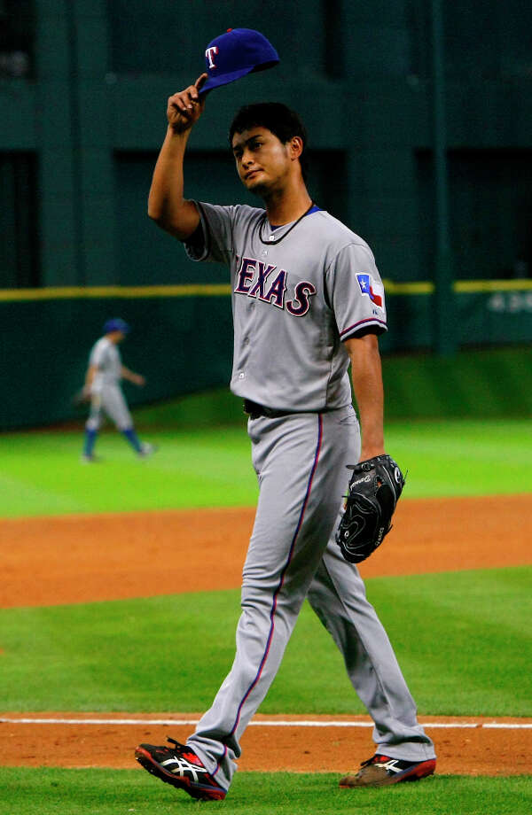 Rangers pitcher Yu Darvish acknowledges the crowd after leaving the game. Photo: Cody Duty / © 2013 Houston Chronicle
