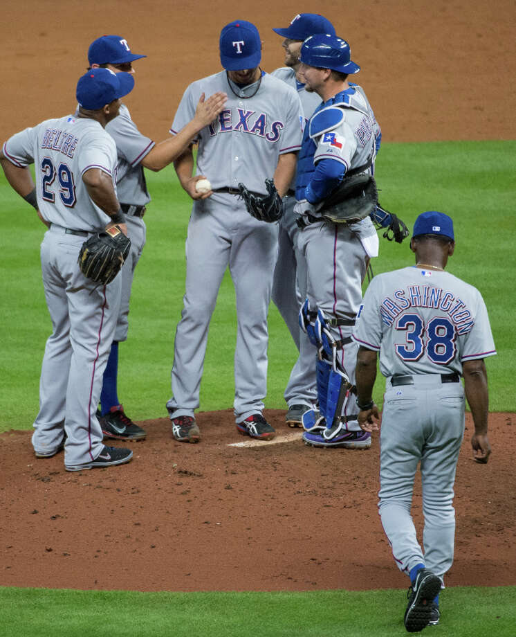 Rangers pitcher Yu Darvish is pulled after allowing a single in the ninth inning. Photo: Smiley N. Pool / © 2013  Smiley N. Pool