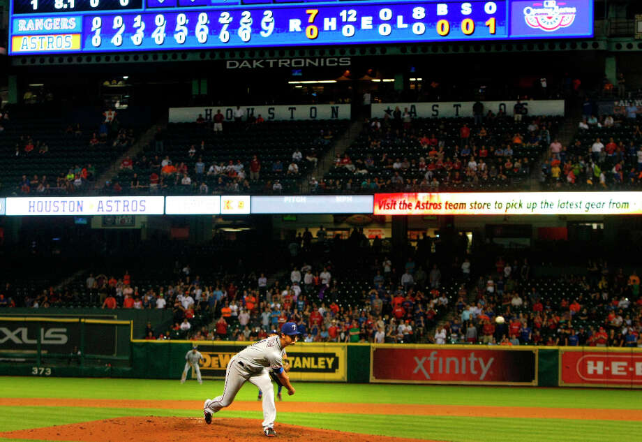 Rangers pitcher Yu Darvish throws a pitch against the Astros during the ninth inning. Photo: Cody Duty / © 2013 Houston Chronicle