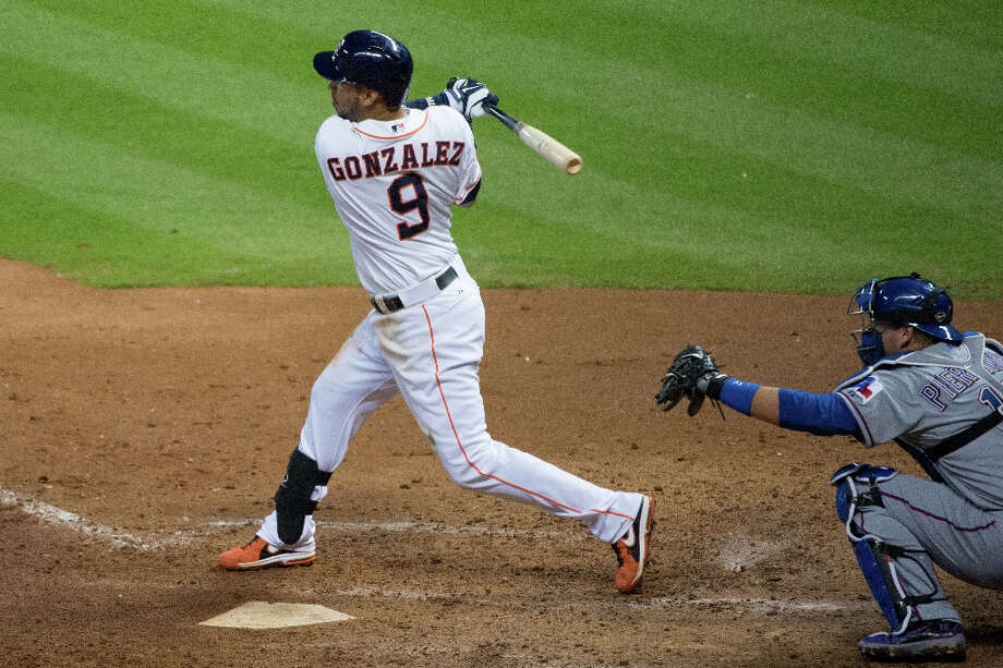 Astros shortstop Marwin Gonzalez singles off Rangers pitcher Yu Darvish in the ninth inning. Photo: Smiley N. Pool / © 2013  Smiley N. Pool