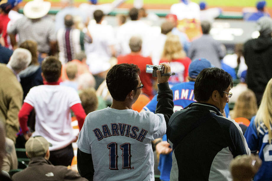 Rangers fans aim their cameras at Rangers pitcher Yu Darvish during his bid for a perfect game. Photo: Smiley N. Pool / © 2013  Smiley N. Pool