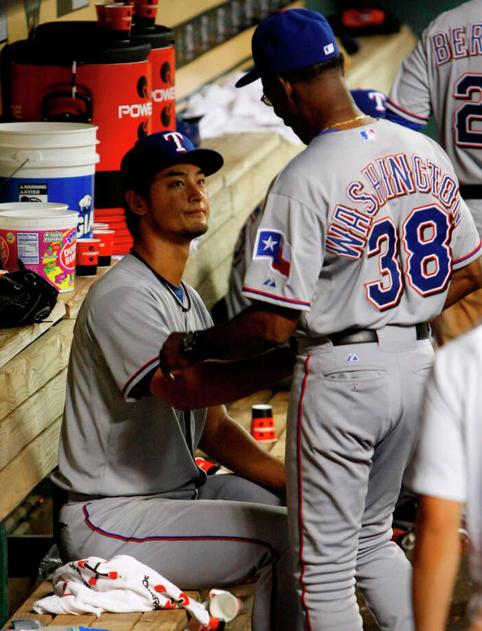 Rangers manager Ron Washington hugs Yu Darvish after he almost threw for a perfect game against the Astros. Photo: Cody Duty / © 2013 Houston Chronicle