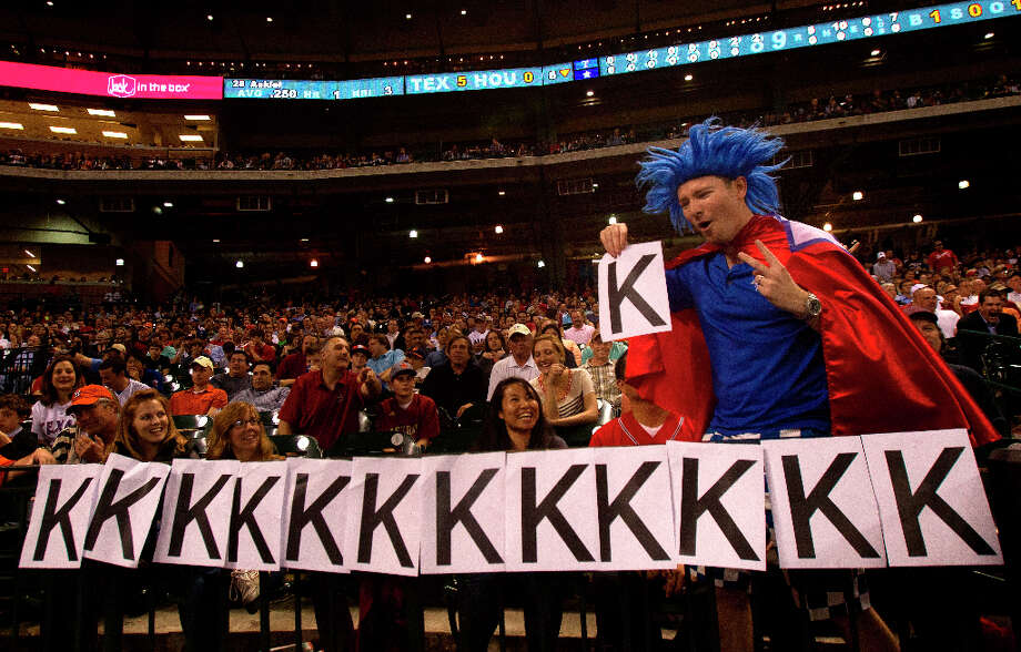 A Rangers fan signals another strikeout by Rangers pitcher Yu Darvish against the Astros. Photo: Cody Duty / © 2013 Houston Chronicle