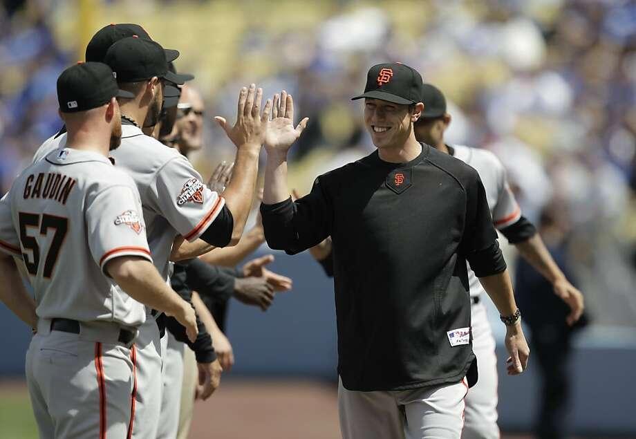 Giants starting pitcher Tim Lincecum greets his teammates before Monday's season opener at Dodger Stadium. Photo: Jae C. Hong, Associated Press