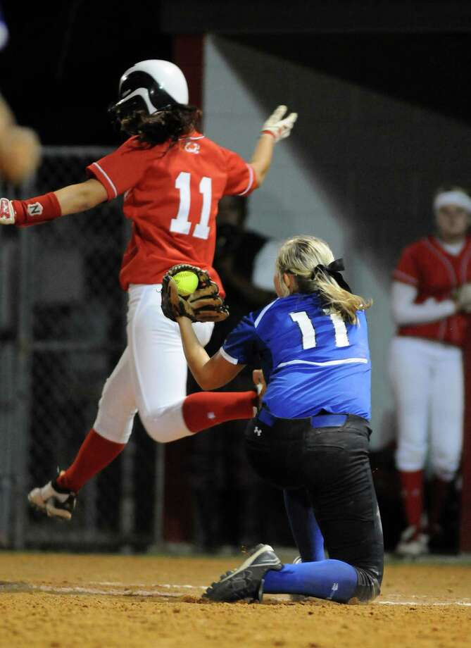 New Caney senior first baseman Kindell Gainer, right, tags out Crosby sophomore Jamie Hofmann for the final out of their District 19-4A matchup at Crosby High School on Tuesday. Photo: Jerry Baker, For The Chronicle