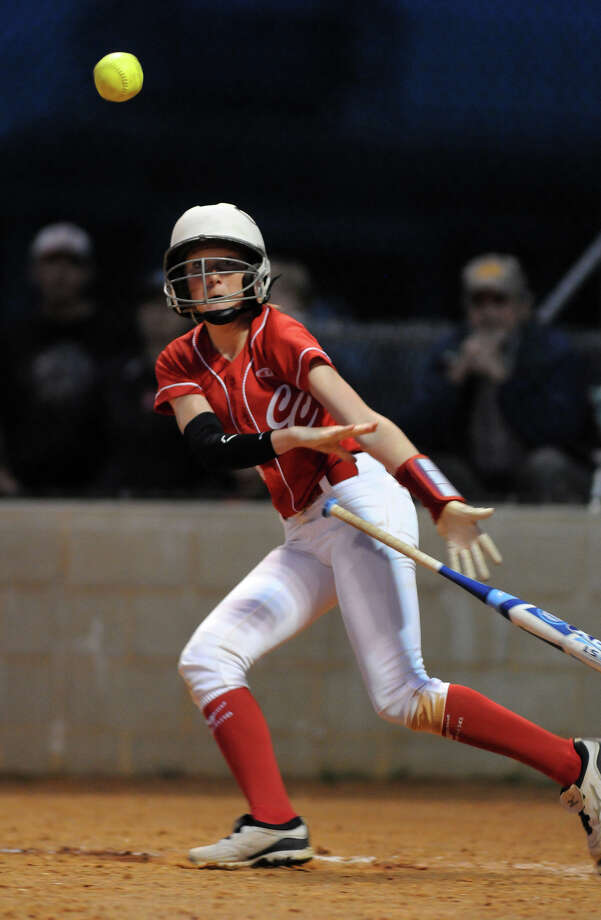 Crosby freshman centerfielder Kaitlyn Stebelton bunts for a base hit in the bottom of the fifth inning against New Caney during their District 19-4A matchup at Crosby High School on Tuesday. Photo: Jerry Baker, For The Chronicle