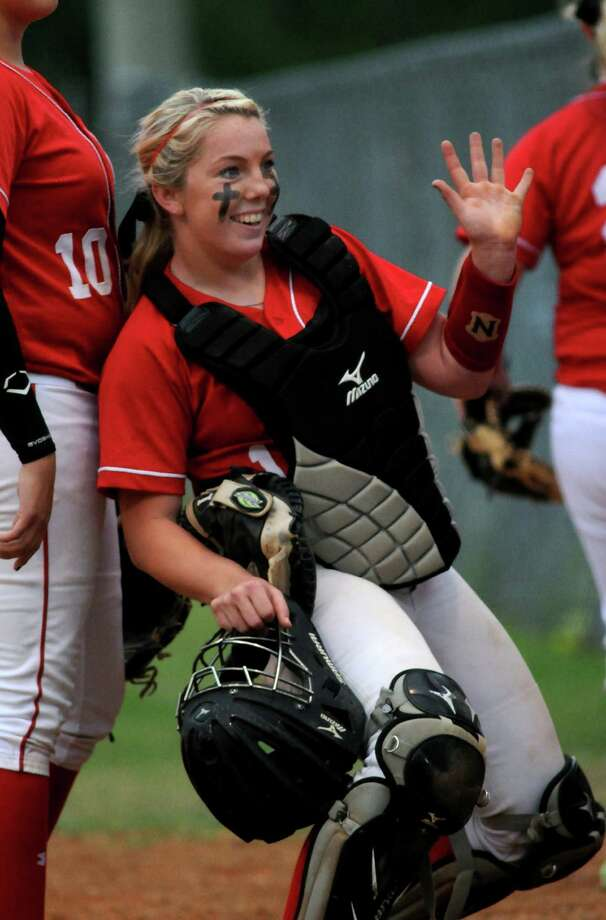 Crosby junior catcher Ariel Clogston waves to a fan between innings of their District 19-4A matchup versus New Caney at Crosby High School on Tuesday. Photo: Jerry Baker, For The Chronicle