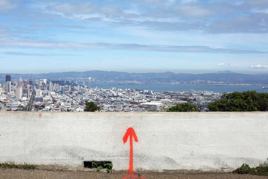 A spray painted arrow is seen on a concrete barrier on Twin Peaks on March 26, 2013 in San Francisco, Calif. Photo: Pete Kiehart, The Chronicle / ONLINE_YES