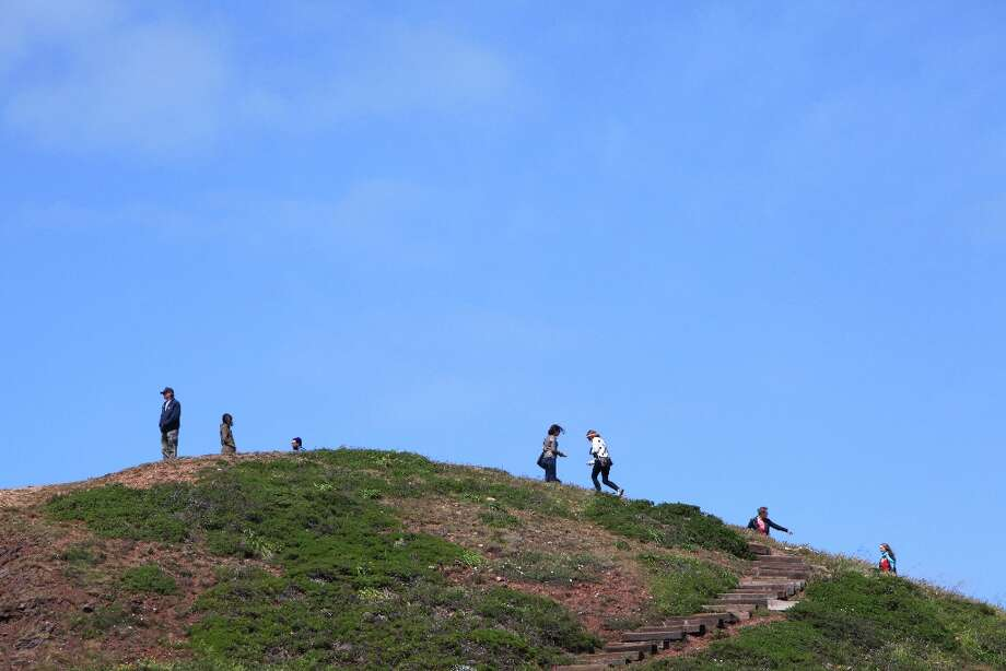 Visitors to Twin Peaks explore the North peak on March 26, 2013 in San Francisco, Calif. Photo: Pete Kiehart, The Chronicle / ONLINE_YES