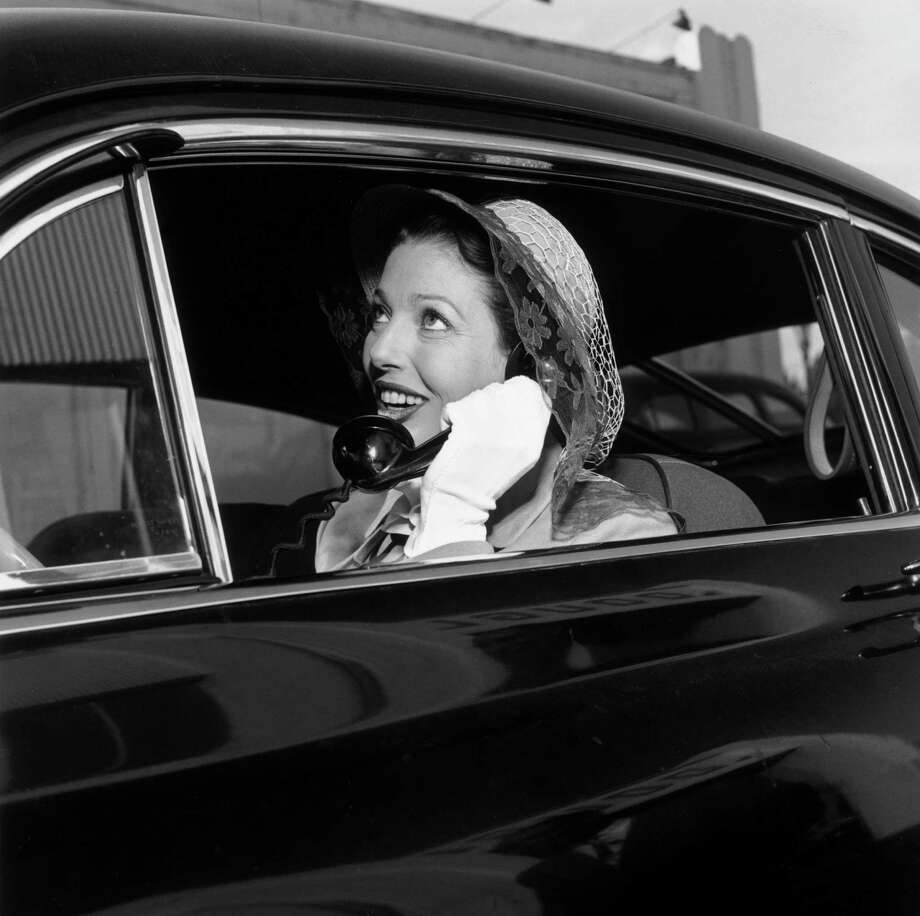 American actor Loretta Young speaks on a car phone in 1950, but in those days mobile radio phones were pretty much just that — two-way radios. Photo: Murray Garrett, File / Archive Photos