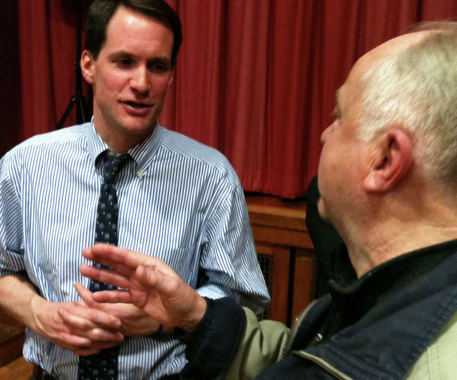 U.S. Rep. Jim Himes, D-4, talks with a constituent after Himes' Tuesday night Town Hall-style meeting in Roger Sherman School. FAIRFIELD CITIZEN, CT 4/2/13 Photo: Andrew Brophy / Fairfield Citizen contributed