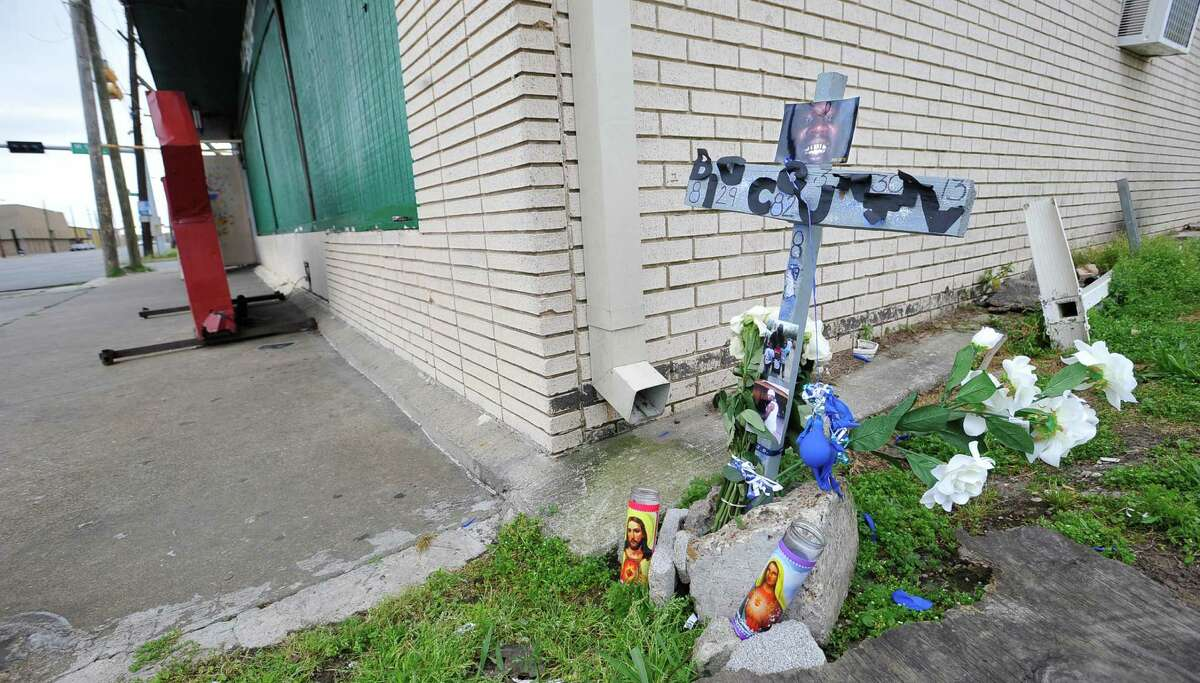 On Tuesday afternoon, outside the entrance to the Old School Shack Lounge on Houston Avenue, a memorial to Marcus John