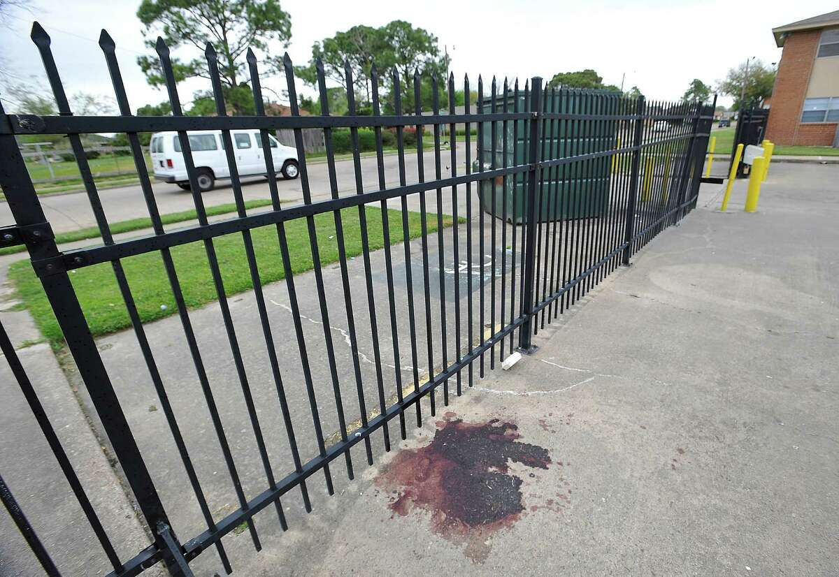 A drying puddle of blood can still be seen Tuesday afternoon at the site of a shooting over the weekend at the Prince Hall Apartment Complex in Port Arthur. This shooting followed a shooting earlier at the Old School Shack Lounge where Marcus John