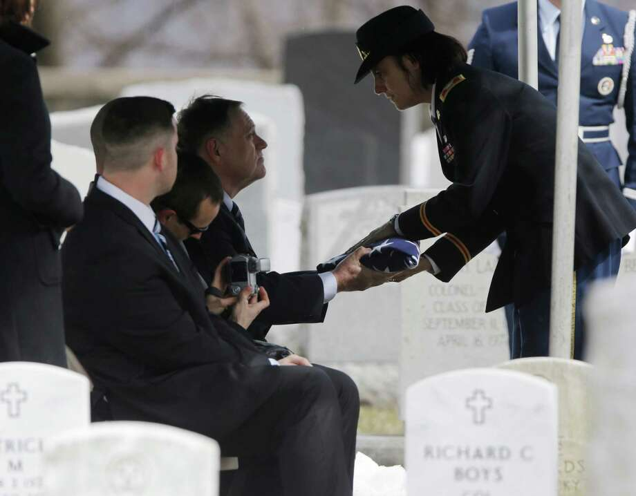 Col. Cindy Jebb, right, presents a flag to David Strong during a burial service at the West Point Cemetery on Friday, March 22, 2013, in West Point, N.Y. The service was for Strong's parents Maj. Gen. Robert Strong and Virginia Strong. Graves of soldiers from every U.S. war make this small plot of the land the most hallowed ground on the nation's the most venerable military academy. And after 196 years and more than 8,000 souls, it's close to full. Photo: Mike Groll, AP / AP