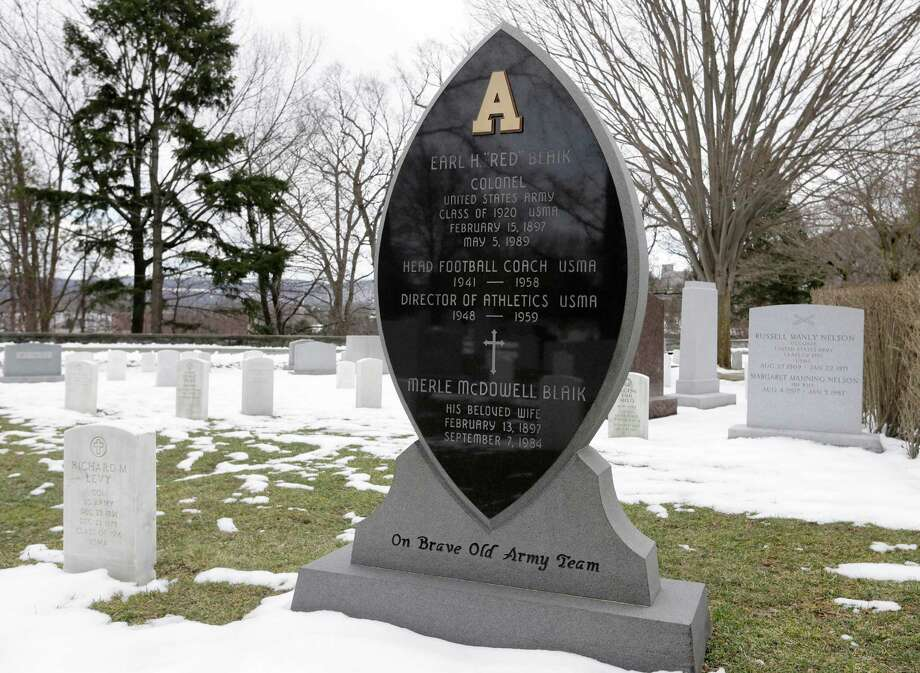 "The headstone of celebrated Army football coach Earl ""Red"" Blaik is seen at the West Point Cemetery on Friday, March 22, 2013, in West Point, N.Y. Graves of soldiers from every U.S. war make this small plot of the land the most hallowed ground on the nation's the most venerable military academy. And after 196 years and more than 8,000 souls, it's close to full. Photo: Mike Groll, AP / AP"
